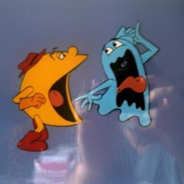 Pac-Man Cartoon: Pac-Man ghost chomping animation cel