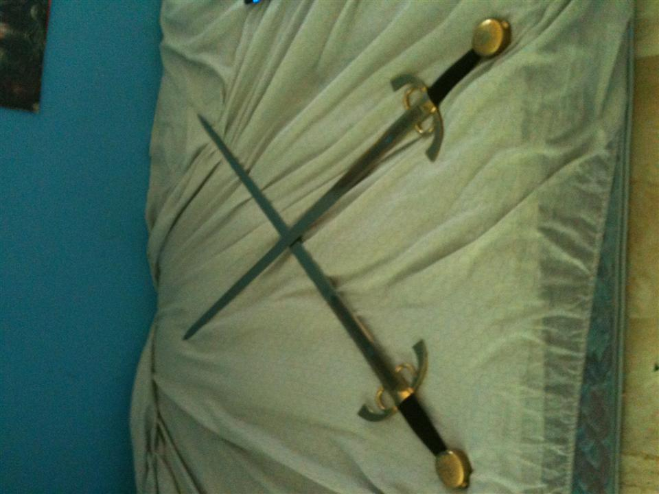 Two one-handed Toledo Swords